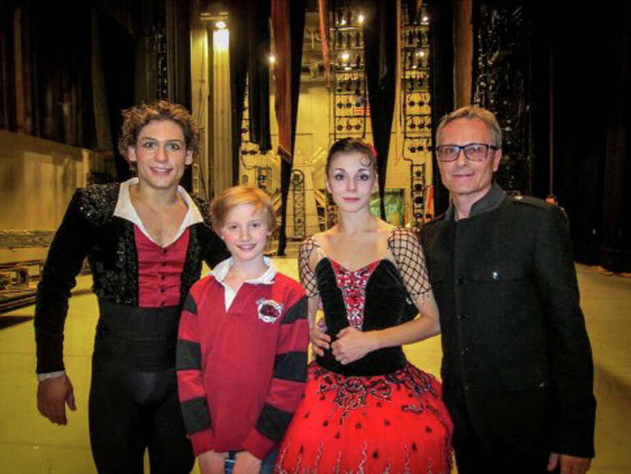"Greenwich Ballet Academy dancer and Eastern Middle School sixth grader Aidan Buss, 12, is pictured backstage with Russian dancers Ivan Vasiliev and Natalia Osipova at the conclusion of the final performance of the Mikhailovsky Ballet's ""Don Quixote."" On the right is Yuri Voldolaga, artistic director at the GBA. Photo: Contributed Photo / Greenwich Time Contributed"