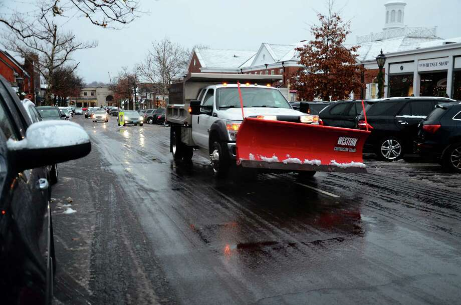 Town and private plow trucks were seen around New Canaan, Conn., Wednesday, Nov. 26, 2014, as residents braced for a wet mix of snow and rain. Photo: Nelson Oliveira / New Canaan News