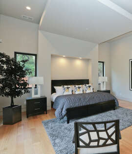 The master suite of the four bedroom home includes glass pocket doors that open to the courtyard.