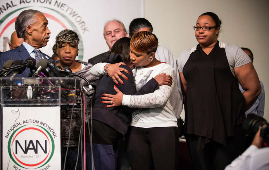 Lesley McSpadden, Michael Brown's mother (center, right), hugs a supporter in New York. Photo: Andrew Burton / Getty Images / 2014 Getty Images