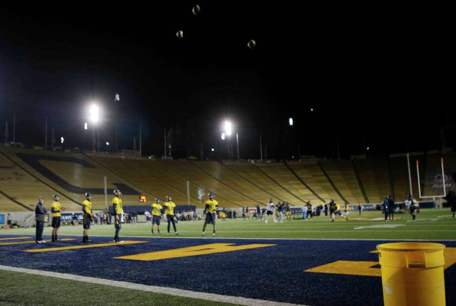 Cal's quarterbacks spend hours on an end-zone drill trying to make short passes come to rest in a bucket. Photo: Jessica Christian / The Chronicle / ONLINE_YES