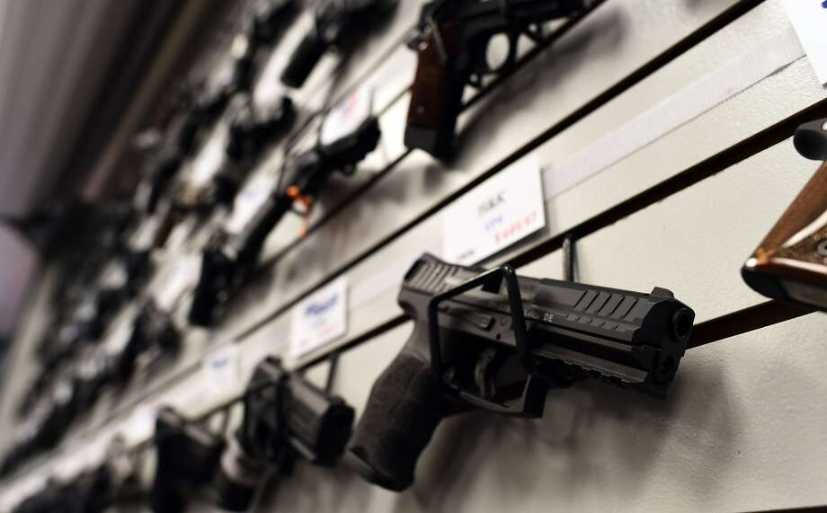 Friday opens the busiest season for gun purchases, when requests for background checks speed up to nearly two a second, testing the limits of the FBI's ability to conduct those checks. Photo: JEWEL SAMAD / AFP/Getty Images / AFP