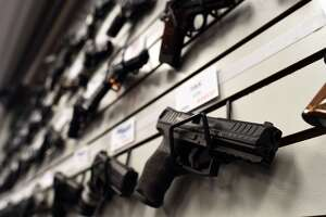 Surging gun sales swamp FBI background-check system - Photo