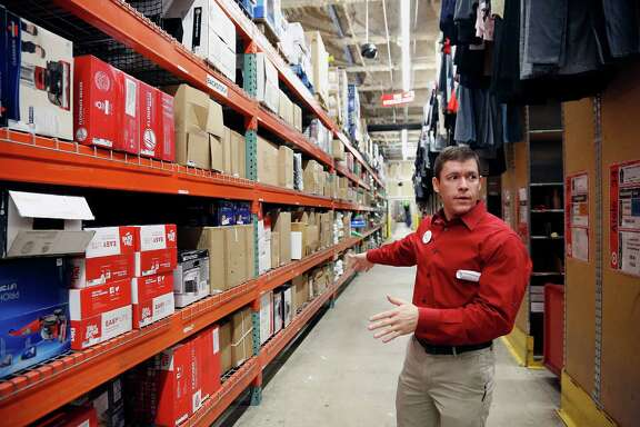 Store Team Leader Jayson Matos points out merchandise in the warehouse  of the Target store in the 4300 block of San Felipe Monday, Nov. 24, 2014, in Houston.  ( James Nielsen / Houston Chronicle )