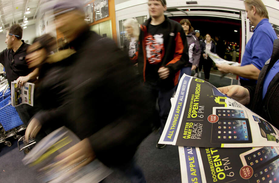 Shoppers enter a Best Buy as the store opens last Thanksgiving — drawn by the big discounts, which don't necessarily add up to profit for the retailer. Photo: Charlie Riedel / Associated Press / AP