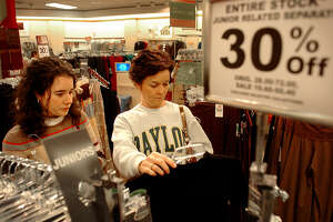 Shanda Boswell, left, and her mother, Debbie, look over clothes on sale at a Belk Department Store in Paris, Texas, Saturday, Nov. 26, 2005. The Boswells were one of many families out early Saturday morning trying to take advantage of the last of the holiday sales. (AP Photo/Paris News, Sam Craft) ** MANDATORY CREDIT **