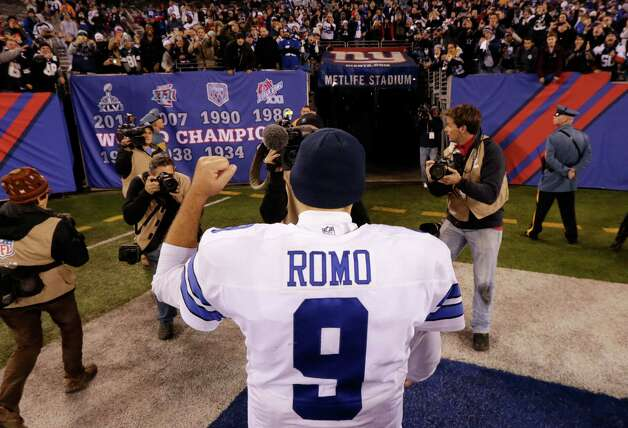 Dallas Cowboys quarterback Tony Romo (9) reacts as he walks off the field after the Cowboys beat the New York Giants 31-28 in an NFL football game, Sunday, Nov. 23, 2014, in East Rutherford, N.J. (AP Photo/Julio Cortez)  ORG XMIT: ERU140 Photo: Julio Cortez / AP