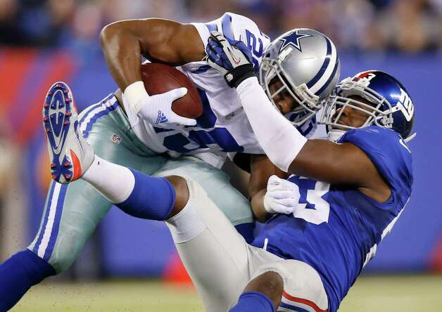 New York Giants middle linebacker Jameel McClain (53) tackles Dallas Cowboys running back DeMarco Murray (29) in the second quarter of an NFL football game, Sunday, Nov. 23, 2014, in East Rutherford, N.J. (AP Photo/Kathy Willens)  ORG XMIT: ERU119 Photo: Kathy Willens / AP