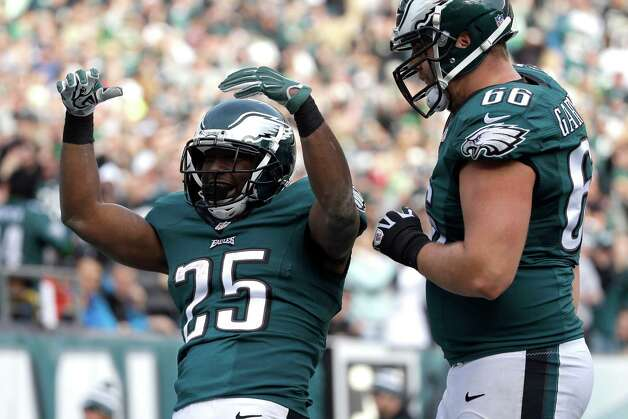 Philadelphia Eagles' LeSean McCoy, left, celebrates with Andrew Gardner after McCoy's touchdown during the first half of an NFL football game against the Tennessee Titans, Sunday, Nov. 23, 2014, in Philadelphia. (AP Photo/Michael Perez) ORG XMIT: PXE115 Photo: Michael Perez / FR168006 AP