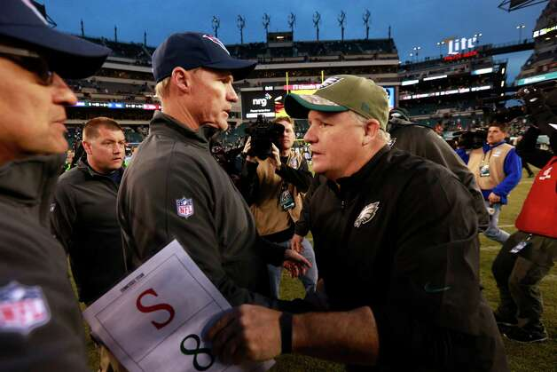 Philadelphia Eagles head coach Chip Kelly, right, meets with Tennessee Titans head coach Ken Whisenhunt after an NFL football game, Sunday, Nov. 23, 2014, in Philadelphia. Philadelphia won 43-24. (AP Photo/Matt Rourke) ORG XMIT: PXE123 Photo: Matt Rourke / AP