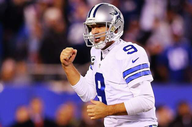 EAST RUTHERFORD, NJ - NOVEMBER 23:  Tony Romo #9 of the Dallas Cowboys celebrates throwing the game winning touchdown pass in the fourth quarter against the New York Giants at MetLife Stadium on November 23, 2014 in East Rutherford, New Jersey. The Cowboys defeated the Giants 31 to 28.  (Photo by Elsa/Getty Images) ORG XMIT: 507869247 Photo: Elsa / 2014 Getty Images