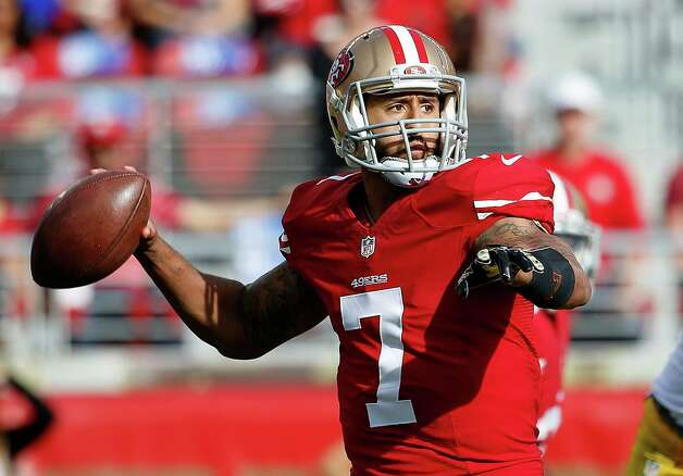 San Francisco 49ers quarterback Colin Kaepernick (7) passes against the Washington Redskins during the first quarter of an NFL football game in Santa Clara, Calif., Sunday, Nov. 23, 2014. (AP Photo/Tony Avelar) ORG XMIT: FXN109 Photo: Tony Avelar / FR155217 AP