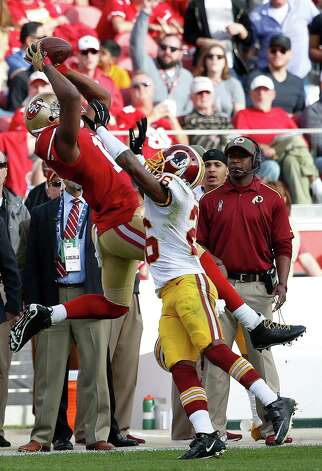 San Francisco 49ers wide receiver Michael Crabtree, left, catches a pass over Washington Redskins cornerback Bashaud Breeland (26) during the second quarter of an NFL football game in Santa Clara, Calif., Sunday, Nov. 23, 2014. (AP Photo/Tony Avelar) ORG XMIT: FXN115 Photo: Tony Avelar / FR155217 AP