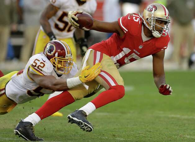 San Francisco 49ers wide receiver Michael Crabtree (15) runs from Washington Redskins linebacker Keenan Robinson (52) during the second half of an NFL football game in Santa Clara, Calif., Sunday, Nov. 23, 2014. (AP Photo/Ben Margot) ORG XMIT: FXN121 Photo: Ben Margot / AP