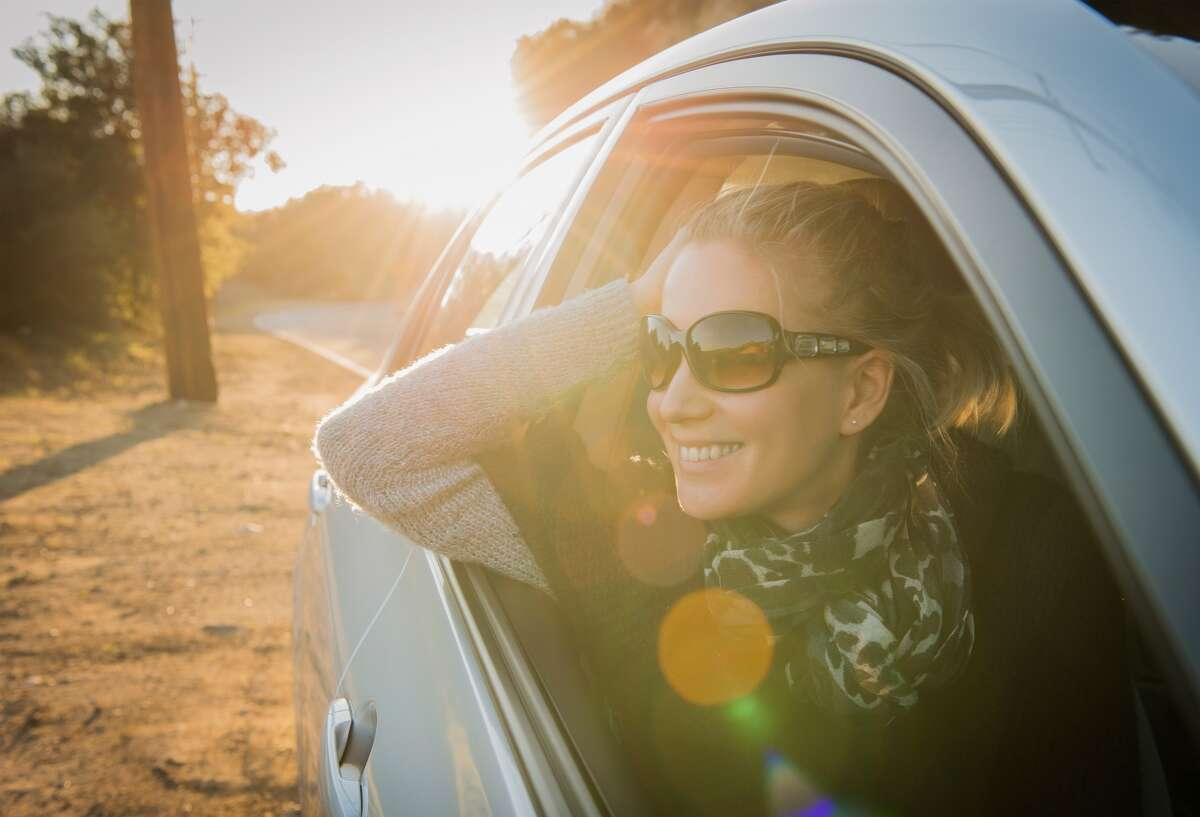 Woman travel car road trip vacation happy