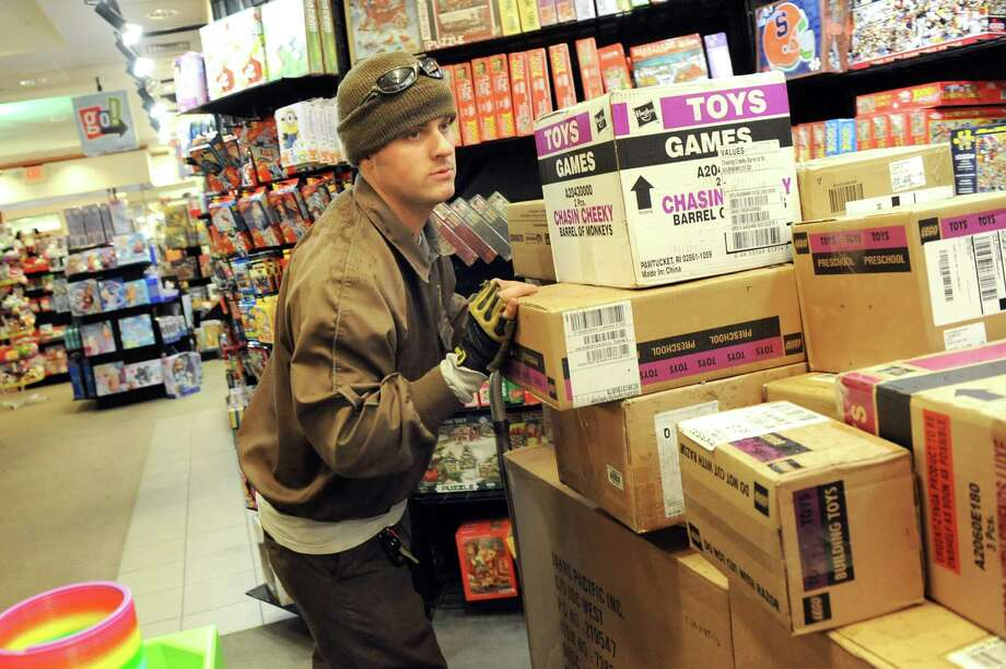 UPS deliveryman Rob Wagner delivers a shipment of toys to go! games & toys on Wednesday, Nov. 26, 2014, at Colonie Center in Colonie, N.Y. (Cindy Schultz / Times Union) Photo: Cindy Schultz / 00029646A