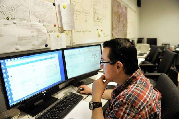 Graduate student Ersin Dincelli works in the infrastructure lab in the School of Business on Tuesday, Nov. 25, 2014, at UAlbany in Albany, N.Y. (Cindy Schultz / Times Union) Photo: Cindy Schultz / 00029641A