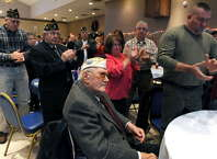 Pearl Harbor attack survivor Seaman 1st Class Charles Ebel, center, receives a round of applause during a Pearl Harbor Day Memorial Observance at the Zalonga American Legion Post on Saturday Dec. 7, 2013 in Albany, N.Y. (Michael P. Farrell/Times Union)