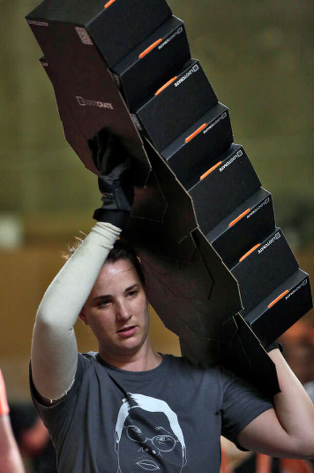 Laurie McDaniel carries boxes for filling at Loot Crate in Los Angeles. Photo: Irfan Khan / McClatchy-Tribune News Service / Los Angeles Times