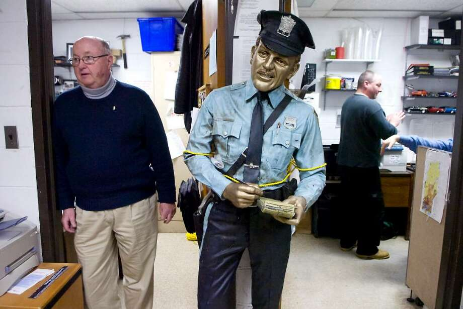 """(L to R) Stamford Police investigator John Whalen and investigator John Russell recently recovered the statue of a police officer title """"Time's Up"""" stolen from downtown Stamford two summers ago and it is held at the Stamford Police Station in Stamford, Conn. on Thursday,  Feb. 25,  2010. Photo: Kathleen O'Rourke / Stamford Advocate"""