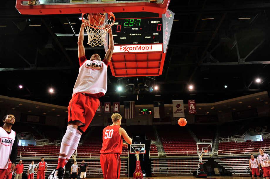 Lamar University's Zjori Bosha dunks the ball on the opening day of the men's basketball practice Friday in the Montagne Center.  Photo taken Friday, October 3, 2014  Kim Brent/@kimbpix Photo: KIM BRENT / Beaumont Enterprise