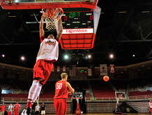 Lamar University's Zjori Bosha dunks the ball on the opening day of the men's basketball practice Friday in the Montagne Center.  Photo taken Friday, October 3, 2014  Kim Brent/@kimbpix