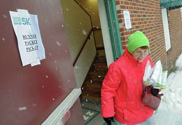 Kathy Higgins of Rotterdam picks up packets for her, her daughter and two grandsons for the Ellis Medicine's Cardiac Classic 5K in Schenectady Central Park on Wednesday, Nov. 26, 2014 in Schenectady, N.Y. The 5K Road Race, Wellness Walk, and Fun Run which happens on Thanksgiving Day draws more than 1,700 runners and walkers each year and supports Ellis Medicine's Wright Heart Center. (Lori Van Buren / Times Union) Photo: Lori Van Buren / 00029602A