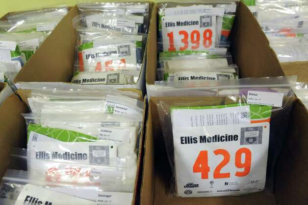 Boxes of runner's packets are seen at the Ellis Medicine's Cardiac Classic 5K packet pickup in Schenectady Central Park on Wednesday, Nov. 26, 2014 in Schenectady, N.Y. The 5K Road Race, Wellness Walk, and Fun Run which happens on Thanksgiving Day draws more than 1,700 runners and walkers each year and supports Ellis Medicine's Wright Heart Center. (Lori Van Buren / Times Union) Photo: Lori Van Buren / 00029602A