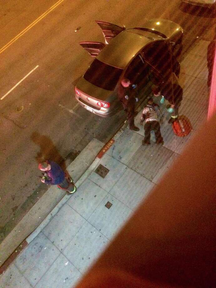 A resident captured one of the victims in Wednesday's shooting from his apartment window. The victim was treated and released from the hospital, police said.