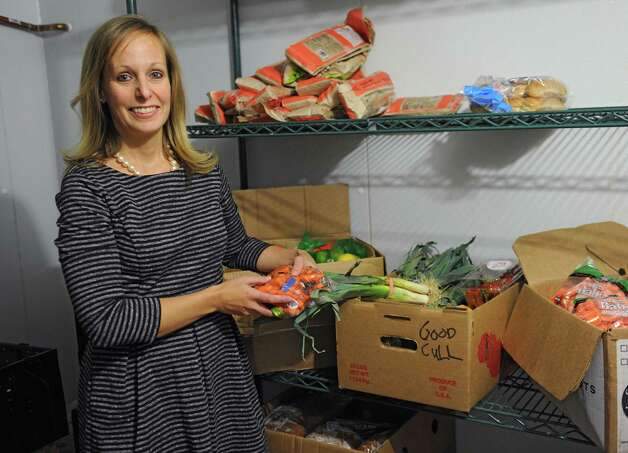 Christine Nealon, director of community resources, stands in the new cooler in the Unity House's The Front Door on Thursday, Nov. 6, 2014, in Troy, N.Y. The large walk-in cooler allows the facility to store larger amounts of produce for the food pantry and community meals. (Lori Van Buren / Times Union) Photo: Lori Van Buren / 00029365A