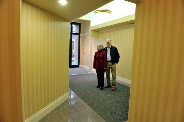 Deane Pfeil and her husband Jeff Pfeil pose inside the lobby at the Pfeil building located at 340 Broadway on Monday, Nov. 17, 2014, in Saratoga Springs, N.Y.   (Paul Buckowski / Times Union) Photo: Paul Buckowski / 00029485A