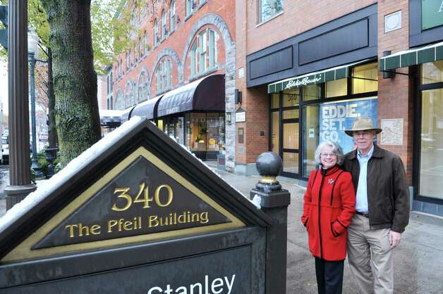 Deane Pfeil and her husband Jeff Pfeil pose outside the Pfeil building located at 340 Broadway on Monday, Nov. 17, 2014, in Saratoga Springs, N.Y.   (Paul Buckowski / Times Union) Photo: Paul Buckowski / 00029485A