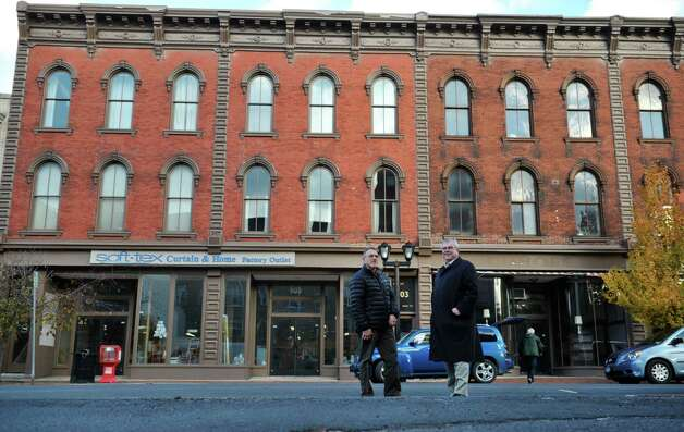 Ralph Pascale, left, grant administrator for the City of Cohoes and Ed Tremblay, director of community and economic development for the city pose across the street from the Adam's block on Remsen St. on Tuesday, Nov. 18, 2014, in Cohoes, N.Y.  (Paul Buckowski / Times Union) Photo: Paul Buckowski / 00029487A