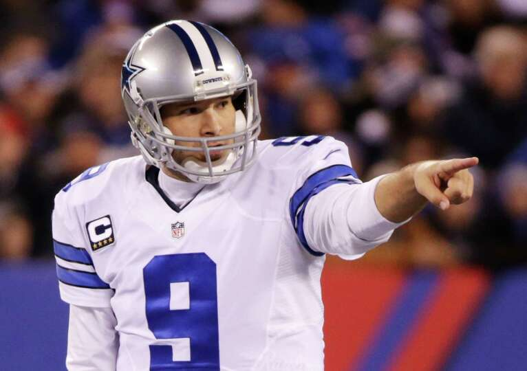 Cowboys quarterback Tony Romo calls an audible at the line of scrimmage against the New York Giants