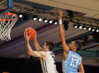 Butler's Alexander Barlow (3), goes up for a shot against UNC's J.P. Tokoto (13) during their game in the Battle 4 Atlantis basketball tournament at Paradise Island, Bahamas, Wednesday Nov 26, 2014. (AP Photo/Tim Aylen) ORG XMIT: BHS112