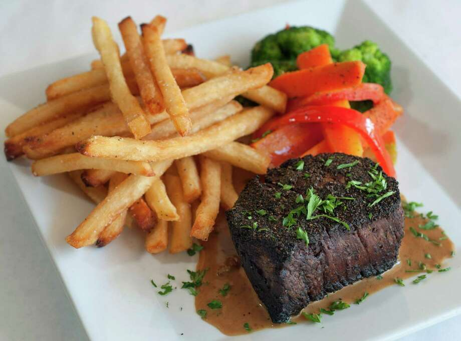 Steak and frites Photo: Express-News File Photo / San Antonio Express-News