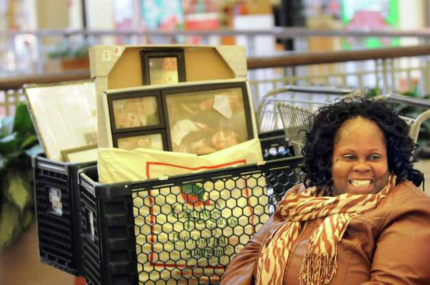 Peachie Everett of Albany takes a break from shopping on Wednesday, Nov. 26, 2014, at Colonie Center in Colonie, N.Y. (Cindy Schultz / Times Union) Photo: Cindy Schultz / 00029646A
