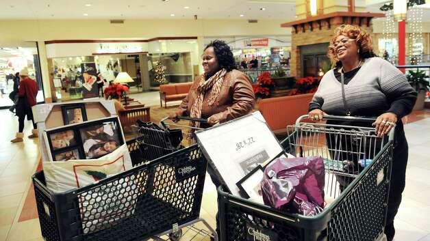 Peachie Everett, left, and her sister-in-law Ann L. Terrell, both of Albany, move their treasures through the mall on Wednesday, Nov. 26, 2014, at Colonie Center in Colonie, N.Y. (Cindy Schultz / Times Union) Photo: Cindy Schultz / 00029646A