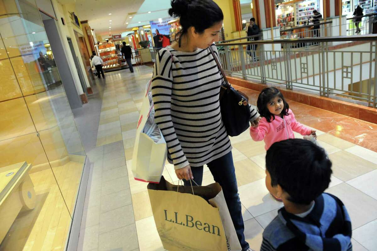 Noreen Muhib, a native of Niskayuna, center, keeps track of her children Aliya Palaniswamy, 3, right, and Zaid Palaniswamy, 5, as they shop on Wednesday, Nov. 26, 2014, at Colonie Center in Colonie, N.Y. (Cindy Schultz / Times Union)