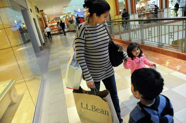 Noreen Muhib, a native of Niskayuna, center, keeps track of her children Aliya Palaniswamy, 3, right, and Zaid Palaniswamy, 5, as they shop on Wednesday, Nov. 26, 2014, at Colonie Center in Colonie, N.Y. (Cindy Schultz / Times Union) Photo: Cindy Schultz / 00029646A