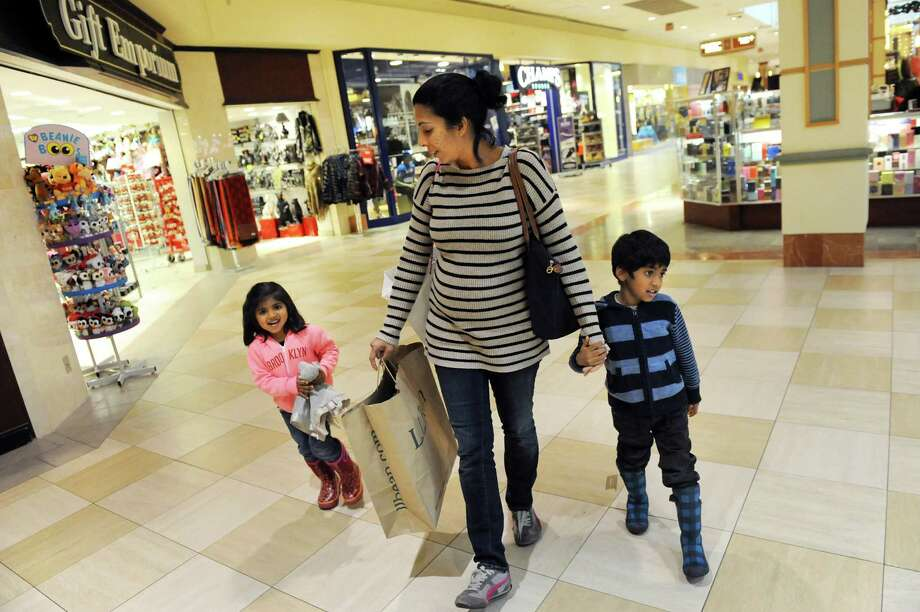 Noreen Muhib, a native of Niskayuna, center, keeps track of her children Aliya Palaniswamy, 3, left, and Zaid Palaniswamy, 5, as they shop on Wednesday, Nov. 26, 2014, at Colonie Center in Colonie, N.Y. (Cindy Schultz / Times Union) Photo: Cindy Schultz / 00029646A