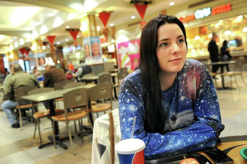 Kasey Docherty of Ballston Spa takes a break from shopping in the food court on Wednesday, Nov. 26,