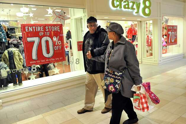 Denise Hart, right, shops with her fiancee Don Fernandez, both of Latham, on Wednesday, Nov. 26, 2014, at Colonie Center in Colonie, N.Y. (Cindy Schultz / Times Union) Photo: Cindy Schultz / 00029646A