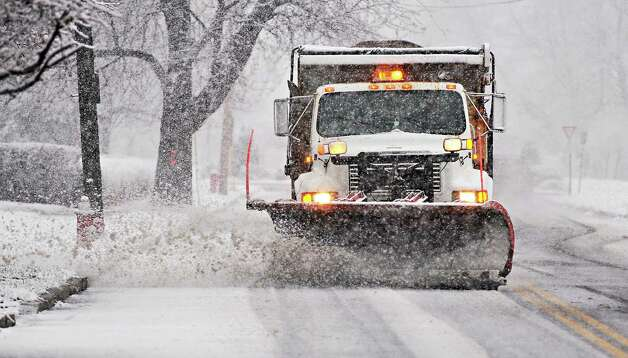 A City of Troy plow clears snow along 15th Street  Wednesday Nov. 26, 2014, in Troy, NY.  (John Carl D'Annibale / Times Union) Photo: John Carl D'Annibale / 00029647A