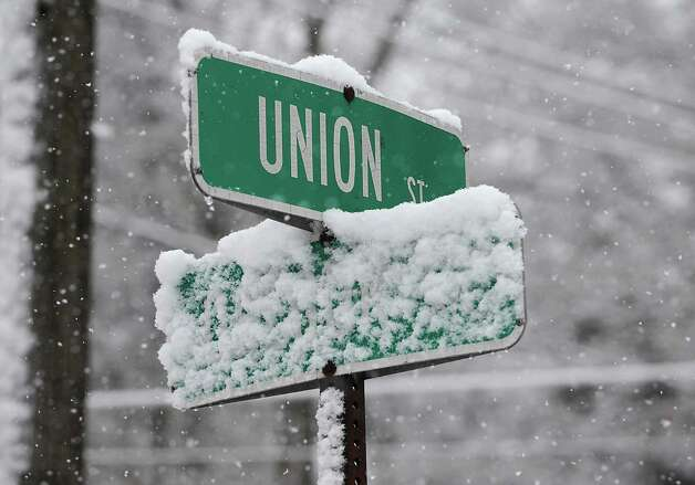 The street sign for Oregon Ave. is unreadable during a snow storm on Wednesday, Nov. 26, 2014 in Schenectady, N.Y. (Lori Van Buren / Times Union) Photo: Lori Van Buren / 00029647A