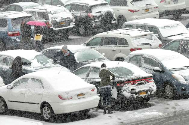 Shoppers deal with the snow in the parking lot on Wednesday, Nov. 26, 2014, at Colonie Center in Colonie, N.Y. (Cindy Schultz / Times Union) Photo: Cindy Schultz / 00029647A