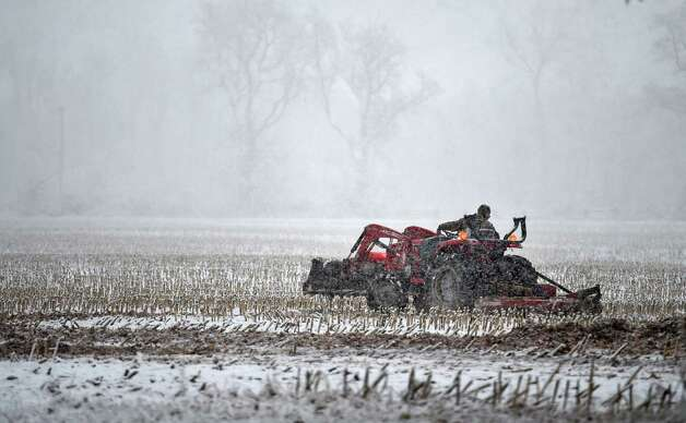 A farmer gets his last chance at working his field Wednesday morning Nov. 26, 2014 in the Town of Stuyvesant, N.Y.  A large amount of snow is forecast for the capital region.   (Skip Dickstein/Times Union) Photo: SKIP DICKSTEIN