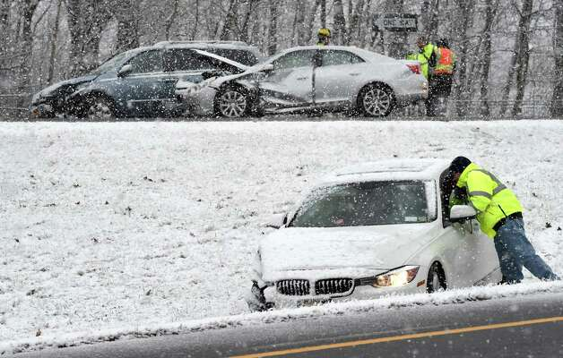 Snow continues to fall as a car sits in the median on Route 9 near Exit 13 of I-87 after a multi-car collision occurred with no injury Wednesday afternoon Nov. 26, 2014 in Saratoga Springs, N.Y.     (Skip Dickstein/Times Union) Photo: SKIP DICKSTEIN