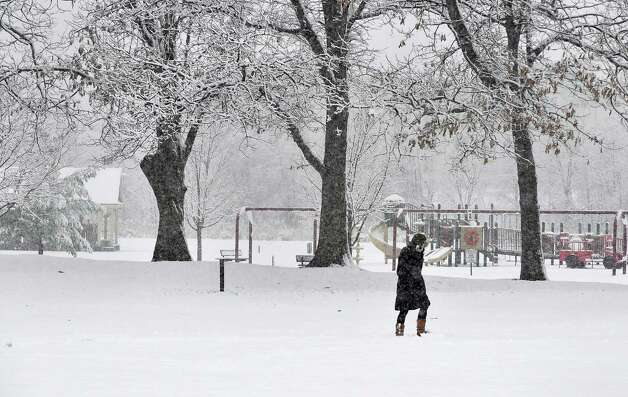 Latham native now living in Calif., Tarry Chung walks through fresh snow at The Crossings o Colonie  Wednesday Nov. 26, 2014, in Colonie, NY.  (John Carl D'Annibale / Times Union) Photo: John Carl D'Annibale / 00029647A