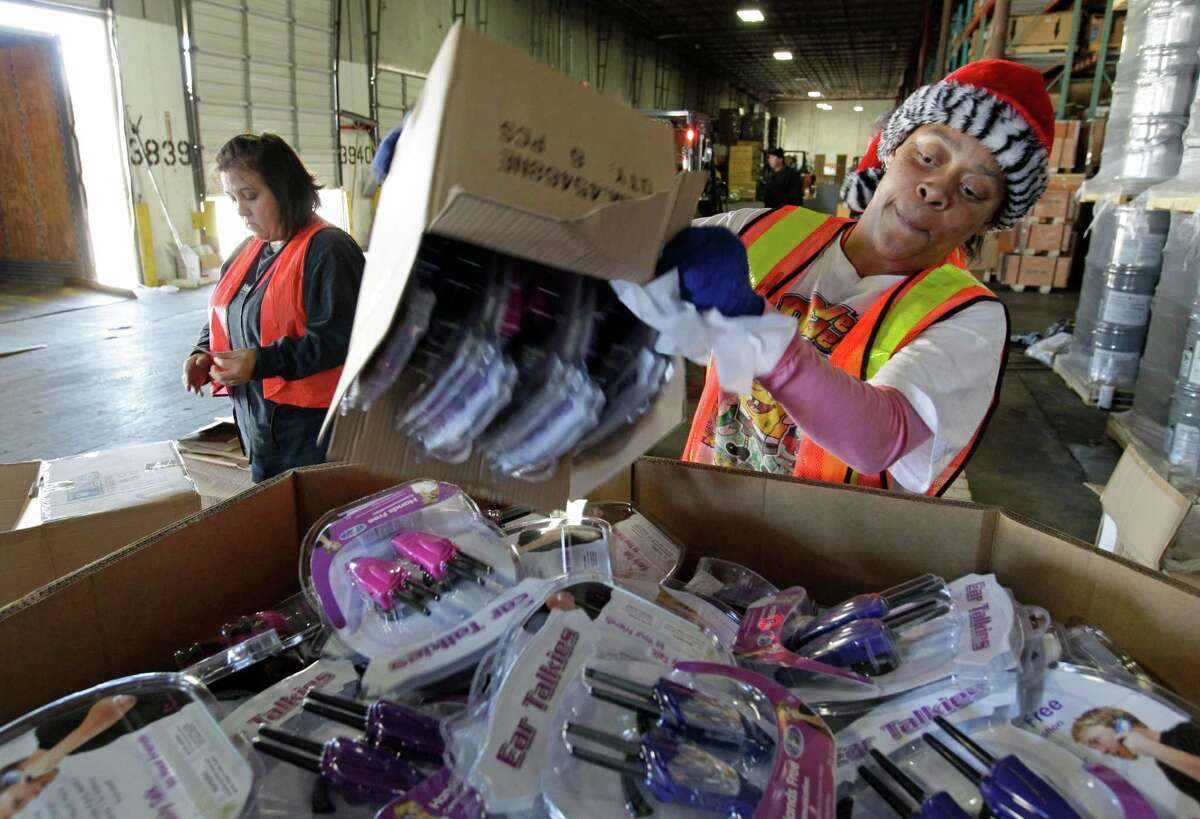 Tammie Gilman, left, and Tamala Taylor are among workers sorting toys for Goodfellows Wednesday.